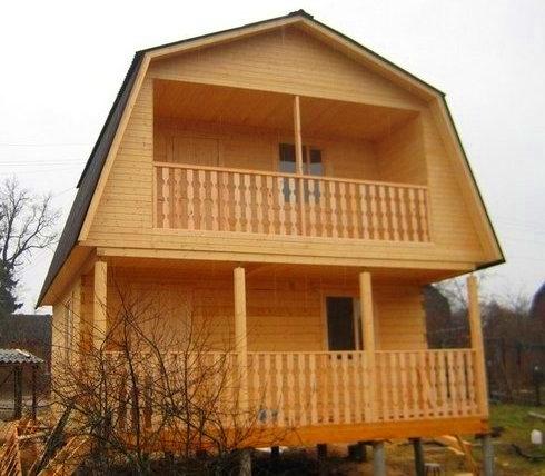 Проект двухэтажного дома из бруса с балконом и террасой б2-6.